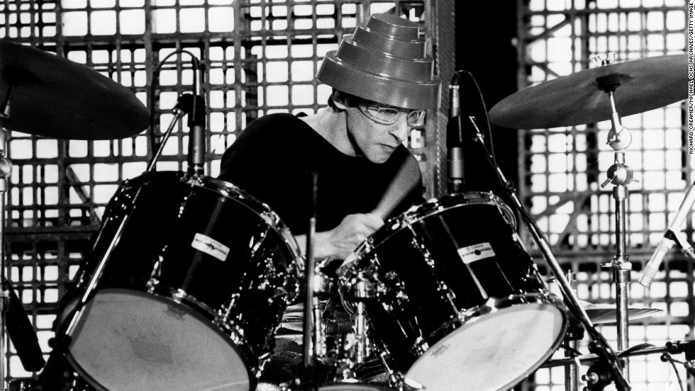 "Alan Myers, Devo's most well-known drummer, <a href=""http://clubdevo.com/index.php?option=com_k2&view=item&id=4689:devo-mourns-passing-of-alan-myers&Itemid=27"" target=""_blank"">lost his battle with cancer</a> on June 24. Band member Mark Mothersbaugh said in a statement that Myers' style on the drums helped define the band's early sound."