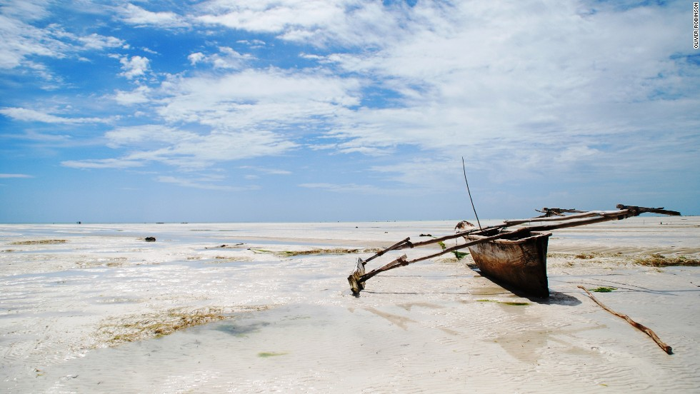 Zanzibar -- beloved by honeymoon couples, beach bums and Freddie Mercury fans. At low tide the azure waters at Paje Beach retreat for miles, leaving a landscape of silver sands punctuated by beached fishing boats.