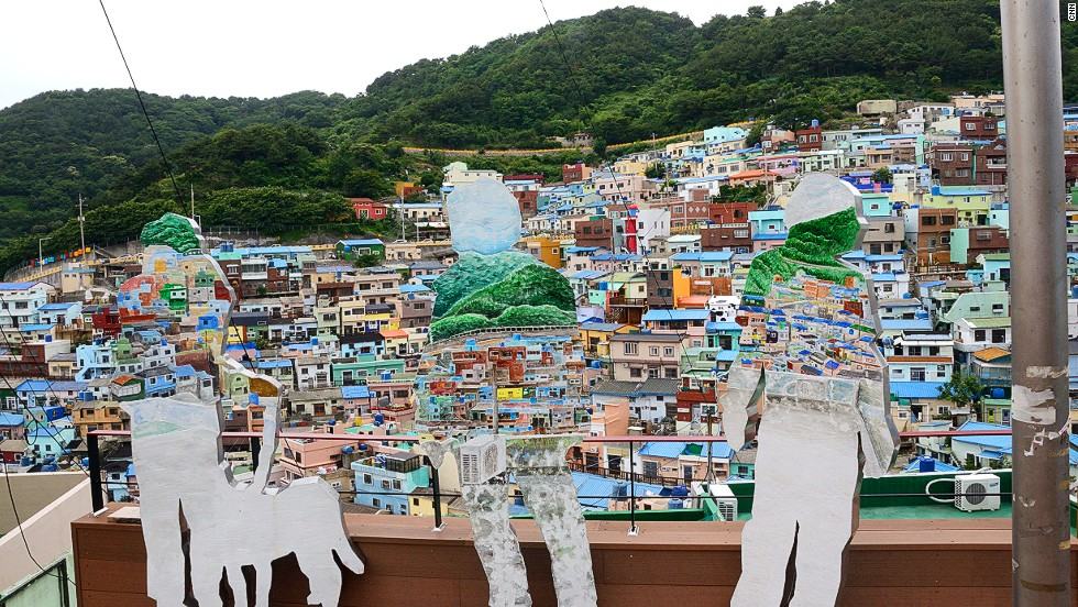 Korean artists and art students have installed various works of art throughout Gamcheon village. Can you spot the painted sculptures in this photo?