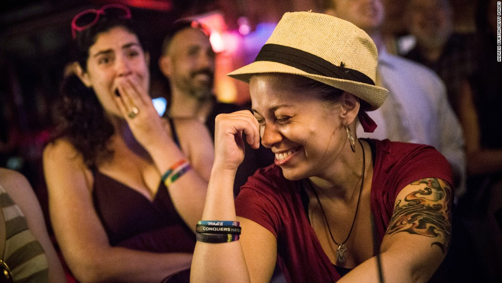 Richelle Spanover, right, celebrates at the Stonewall Inn in New York after the Supreme Court rulings. The Stonewall riots in 1969 sparked the modern gay rights movement.