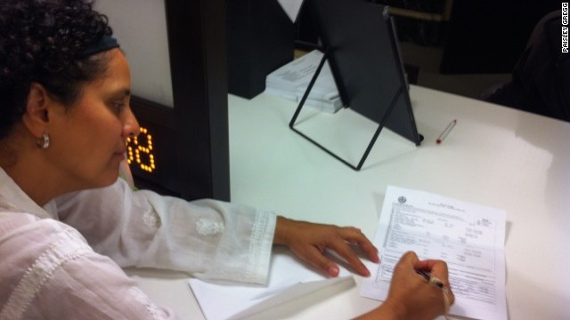 CNN's Rose Arce signs marriage documents at City Hall. Even after the ceremony, she felt she was only 'half married.'
