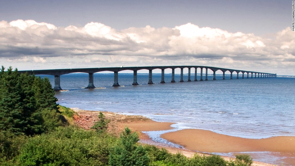 The bridge's curve is designed to help drivers stay alert. <br />Before construction of Confederation Bridge, the only way to reach Prince Edward Island from Canada's mainland was by ferry or airplane.<br />The wind, waves and snow that batter the bridge, which links Canada's smallest province with New Brunswick, forced engineers to come up with a concrete mix that was 60% stronger than most. A purpose-built floating crane, the Svanen, was used to maneuver the individual sections (which included 65 reinforced concrete piers) into place. <strong>Completion date:</strong> May 31, 1997.