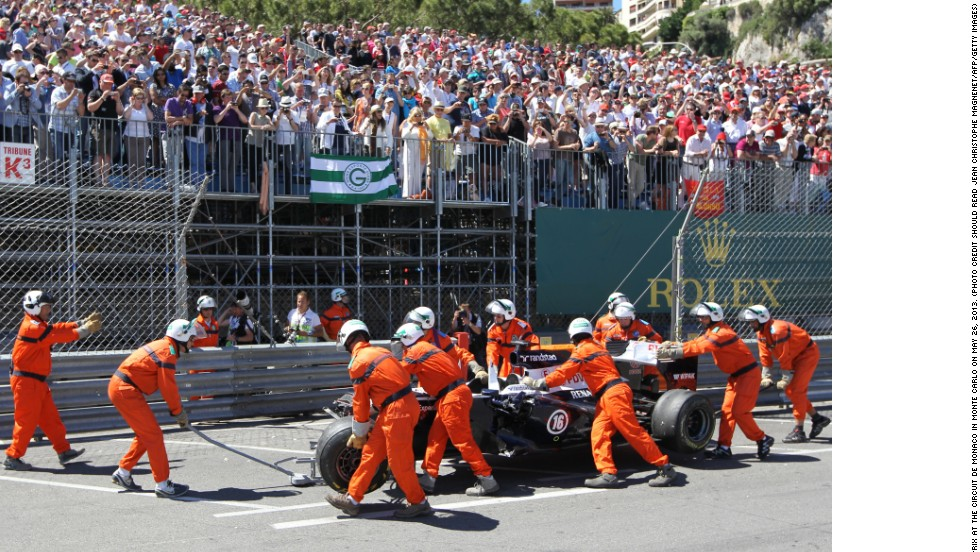 The marshals are on hand to remove debris from track -- and push cars away to safety. Here they help Pastor Maldonado after his Williams comes to a halt in Monaco.