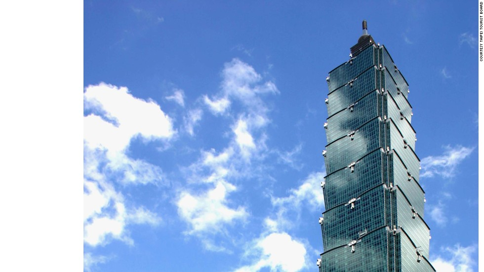 "<strong>Fast fact:</strong> Taipei 101 was the first building in the world to break through 500 meters.<br />Upon its completion, the tower claimed several records: it had the world's fastest elevator, was the world's tallest building and was the world's tallest structure, thanks to its spire. Eight ""mega-columns"" make the building especially earthquake resistant. <strong>Completion date:</strong> December 31, 2004."