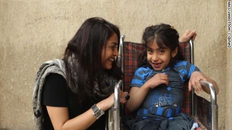 CNN reporter Moni Basu with Noor al-Zahra Haider in Baghdad, March 2013