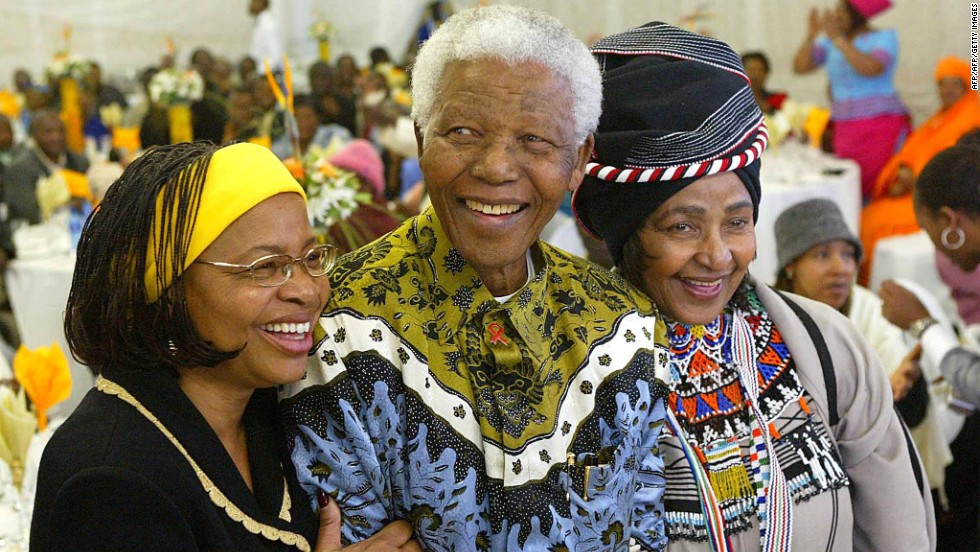 Nelson Mandela celebrates his 86th birthday with his wife, Graca Machel, left, and ex-wife Winnie Madikizela-Mandela in his rural hometown of Qunu in the Eastern Cape Province in 2004.