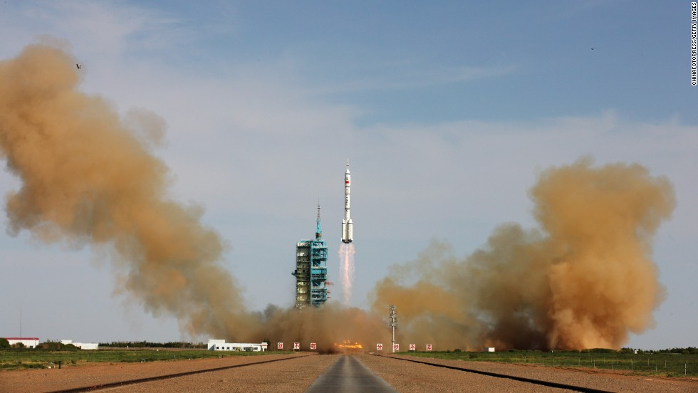 The Long March-2F rocket carrying the Shenzhou 10 spacecraft blasts off from Jiuquan Satellite Launch Center on June 11 in Jiuquan, Gansu province.