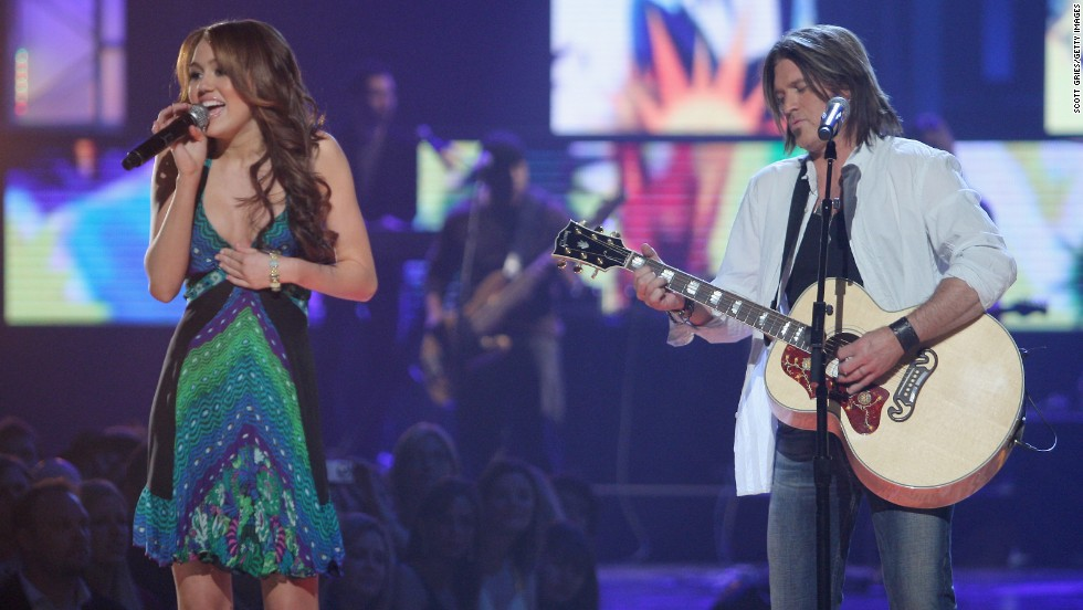 "Miley Cyrus and Billy Ray Cyrus perform ""Ready, Set, Don't Go"" during the 2008 CMT Music Awards. Miley became a tween sensation with her hit Disney Channel show ""Hannah Montana,"" where her real dad starred alongside her as her fictional dad. Billy Ray has since opened up about the strain the family endured because of showbiz. ""I hate to say it, but yes ... I'd take it back in a second,"" <a href=""http://www.gq.com/entertainment/celebrities/201103/billy-ray-cyrus-mr-hannah-montana-miley?currentPage=1"" target=""_blank"">he told GQ in 2011</a>."