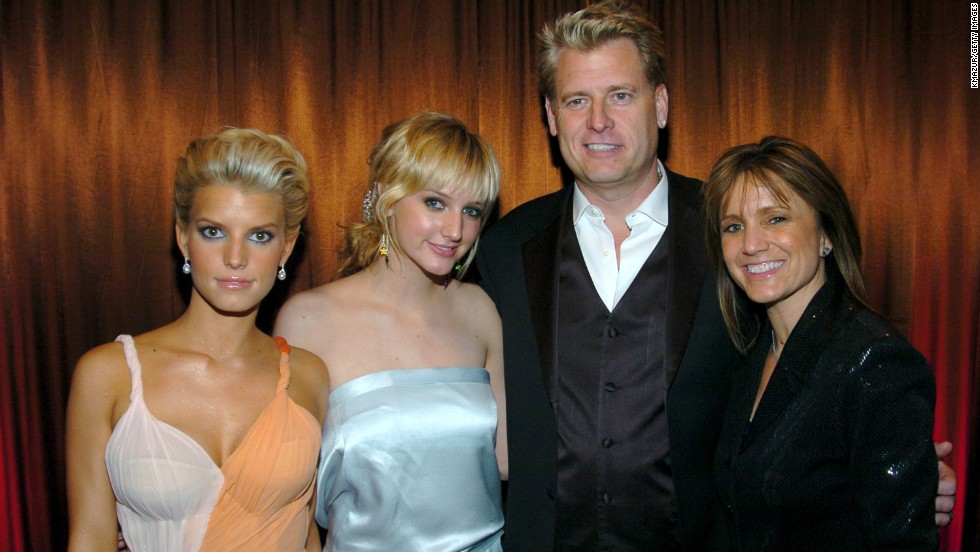"Jessica and Ashlee Simpson pose with their parents, Joe and Tina Simpson. Joe, who became better known as ""Papa Joe"" to fans of Jessica's former reality show ""Newlyweds,"" has managed both his daughters. Joe and Tina finalized their divorce in April 2013 after 34 years of marriage."