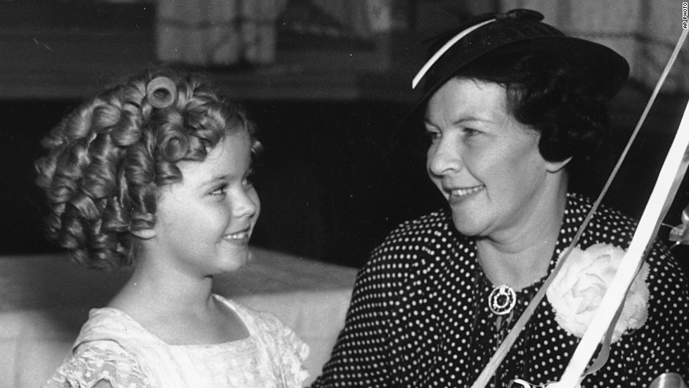 "Shirley Temple celebrates her birthday in 1936 with her mother, Gertrude Temple. Her mother, recognizing her daughter's ""it"" factor, enrolled Shirley in dance classes at age 3. She landed her first film contract at the same age, and soon became one of the earliest and most successful child stars. The actress, now 85, went on to become a U.S. diplomat for the United Nations."