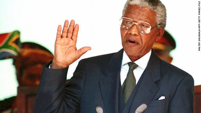 A file photo showing South African Nelson Mandela taking the presidential oath on May 10, 1994 during his inauguration at the Union Building in Pretoria.