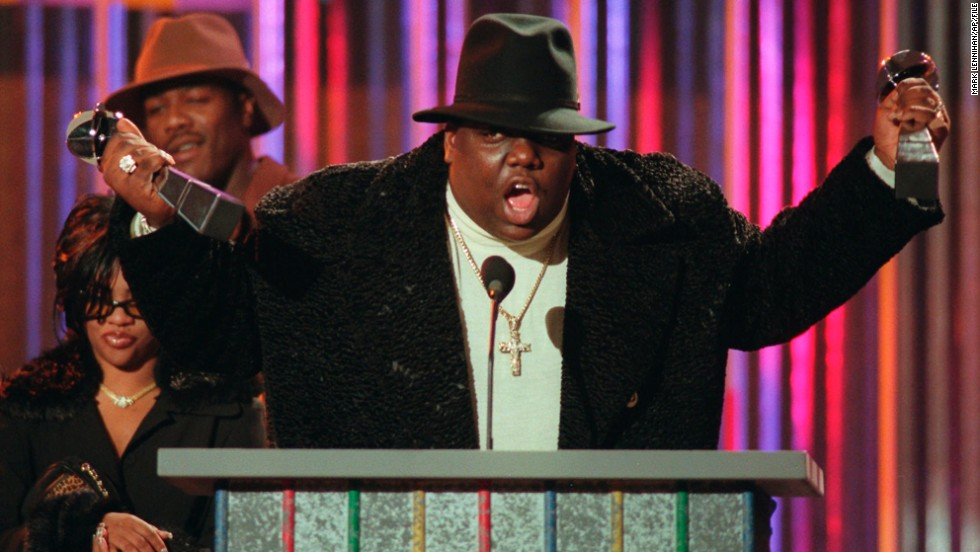 "Just a year after the loss of Tupac, hip-hop weathered the death of another giant of the genre, Notorious B.I.G. <a href=""http://www.cnn.com/2012/12/07/showbiz/notorious-big-autopsy/index.html?iref=allsearch"" target=""_blank"">The rapper was shot and killed at 24</a> while leaving a music industry party in March 1997. Like Tupac's, his slaying remains unsolved."