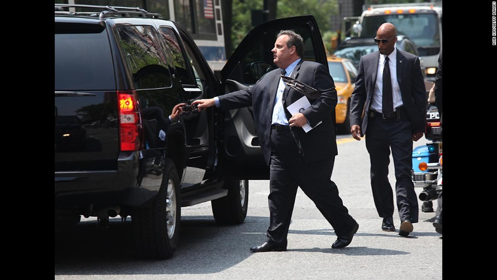 New Jersey Gov. Chris Christie departs the funeral.