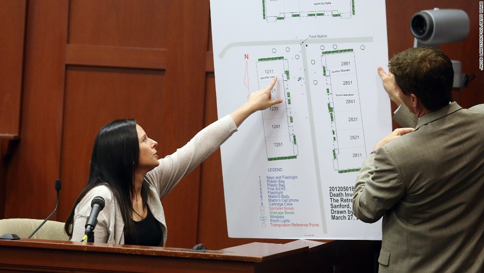 Witness Jennifer Lauer points to where her former home was in the Retreat at Twin Lakes community during questioning by defense attorney Mark O'Mara on June 27. Lauer called 911 on the night of the shooting.