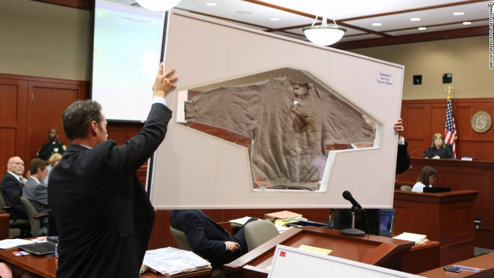 "Assistant state attorneys John Guy, left, and Richard Mantei hold up Martin's sweatshirt as evidence during Zimmerman's trial on June 25. After Martin's death, <a href=""http://www.cnn.com/2012/03/27/living/history-hoodie-trayvon-martin/index.html"">protesters started wearing hoodies</a> in solidarity against racial profiling."