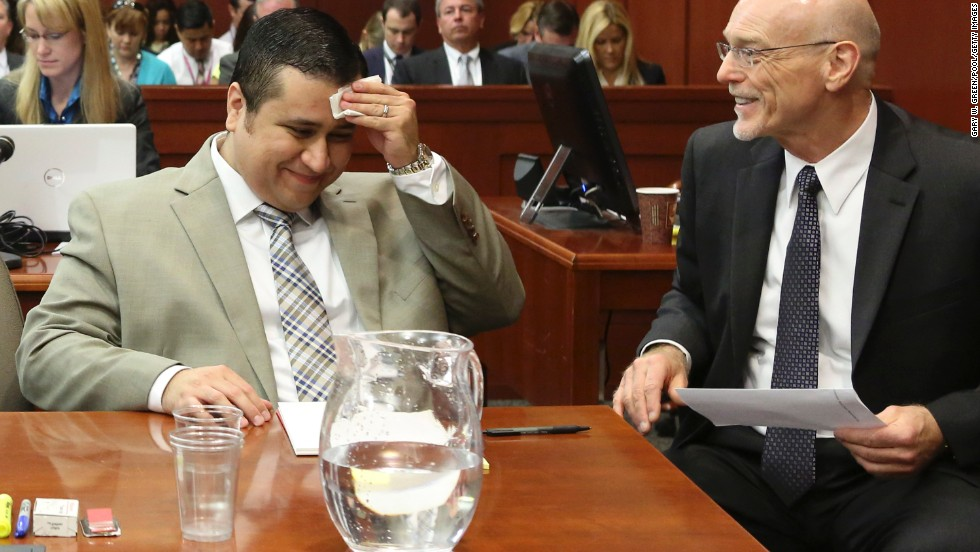Zimmerman laughs with defense attorney Don West during his trial on June 25.