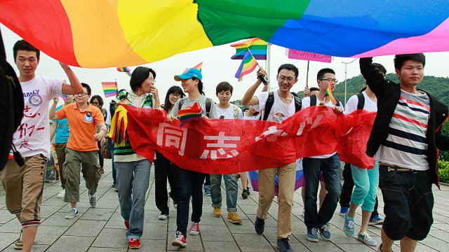 Youngsters hold a rainbow flag, a symbol for the homosexuals, as they march on the street during their anti-discrimination parade in Changsha, central China's Hunan province on May 17, 2013. About one hundred persons gathered to the anti-discrimination parade on the International Day Against Homophobia, appealing for understanding to homosexuals from the mass people. CHINA OUT AFP PHOTOSTR/AFP/Getty Images