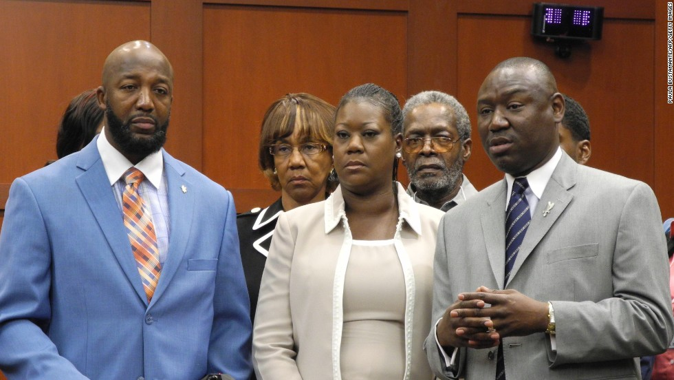From left, Martin's parents, Tracy Martin and Sybrina Fulton, and Benjamin Crump, the family's legal counsel, make a brief statement to the media before jurors heard opening statements on June 24.