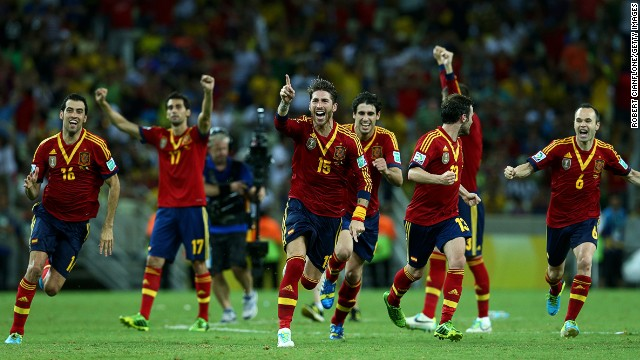 Sergio Ramos leads the celebrations as Jesus Navas' penalty takes Spain to Sunday's Confederations Cup final.
