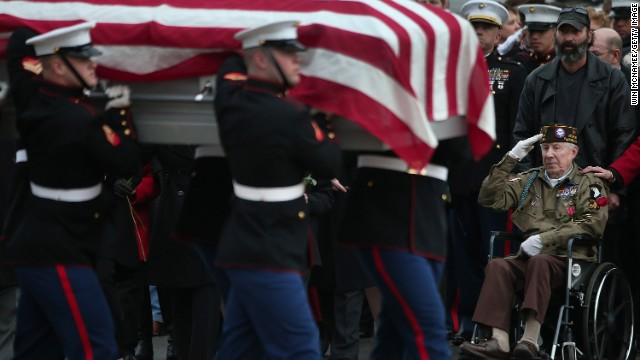 Friends and family of Marine Chief Warrant Officer 3 Gary Stouffer attend his   burial service at Arlington National Cemetery.