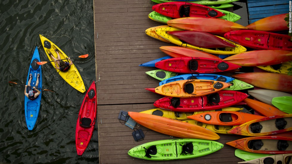 Kayakers cast off from a boathouse on the Potomac River in Washington on June 25.