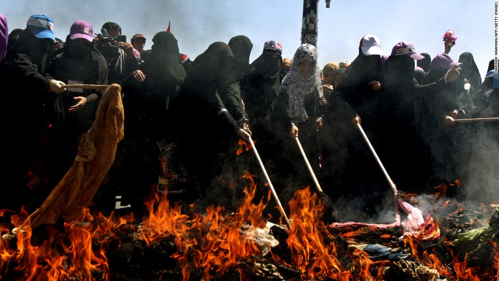 "Yemeni women defiantly <a href=""http://religion.blogs.cnn.com/2011/10/26/yemeni-women-burn-veils-to-protest-regime/"">burn their traditional veils</a> in Sanaa on October 26, 2011, in protest of President Ali Abdullah Saleh's  crackdown on anti-government protesters."