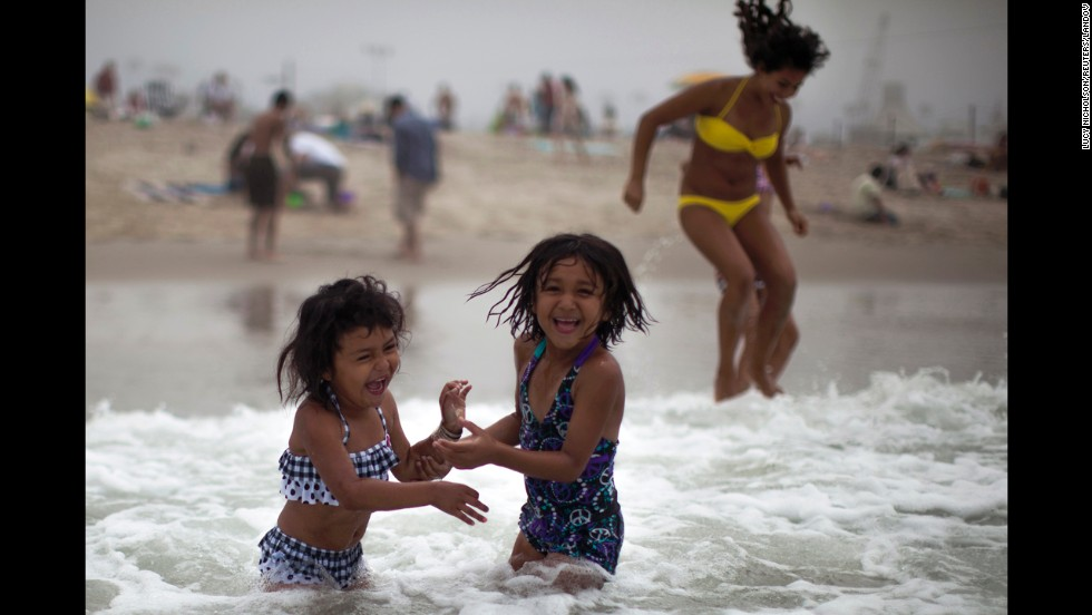 Alana Griego, 5, left, and Celeste Hidalgo, 7, cool off in the Pacific Ocean in Santa Monica, California, on June 28.