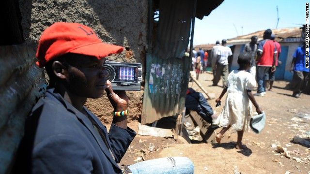 A man listens to a radio in the huge Kibera slum in Nairobi, Kenya, where Kennedy Obede grew up.