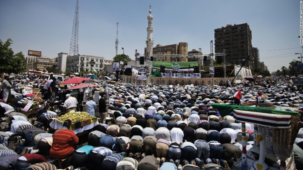 Thousands of Muslim Brotherhood supporters conduct Friday prayers in front of a Cairo mosque before the start of a sit-in for Morsy on June 28.