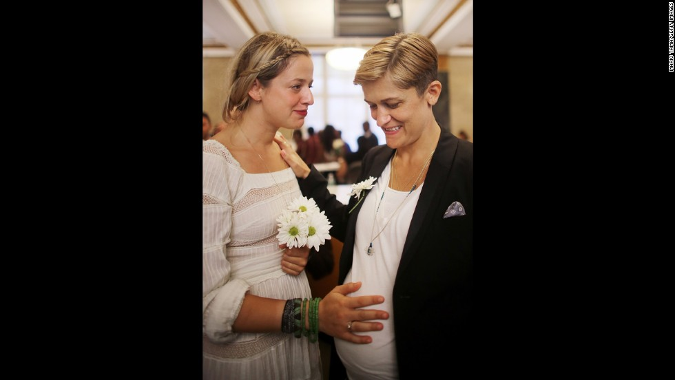 Stefanie Berks, left, touches her pregnant partner, Daisy Boyd, before their marriage at the Manhattan Marriage Bureau in New York on June 28.
