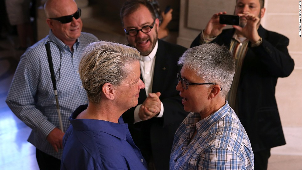 Suzanne Hufft, left, and Val Robb exchange vows as they are married at San Francisco City Hall on June 28.