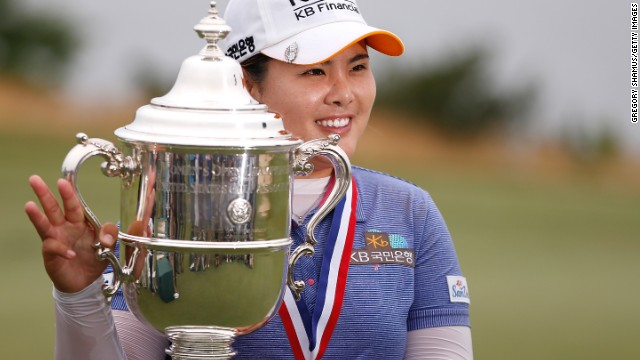Inbee Park holds the U.S. Women's Open trophy aloft after her four-shot victory.
