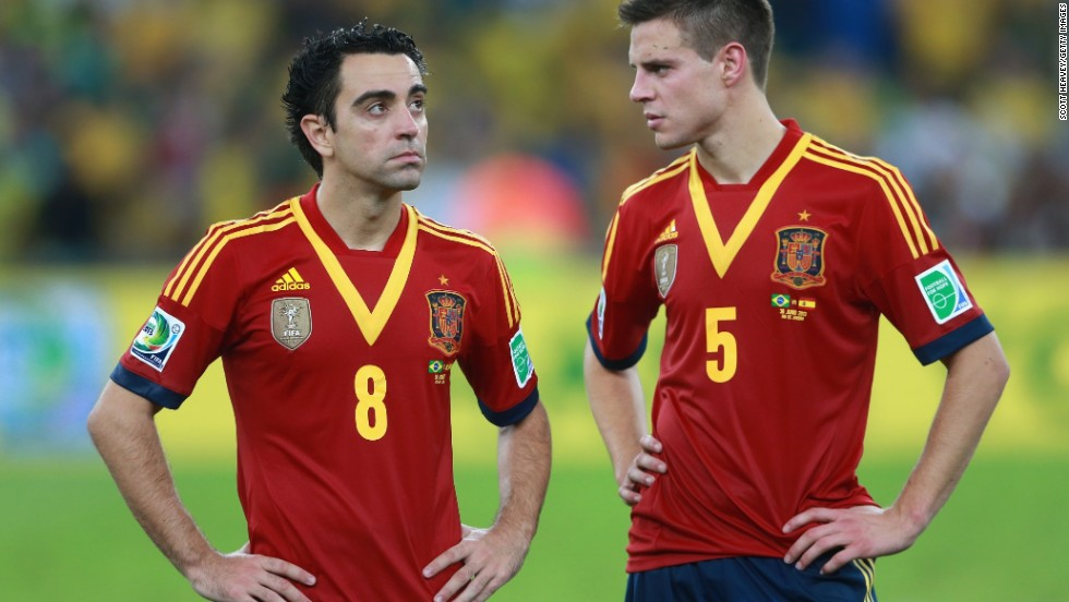 Spain's Xavi and Cesar Azpilicueta of Spain appear dejected in defeat.