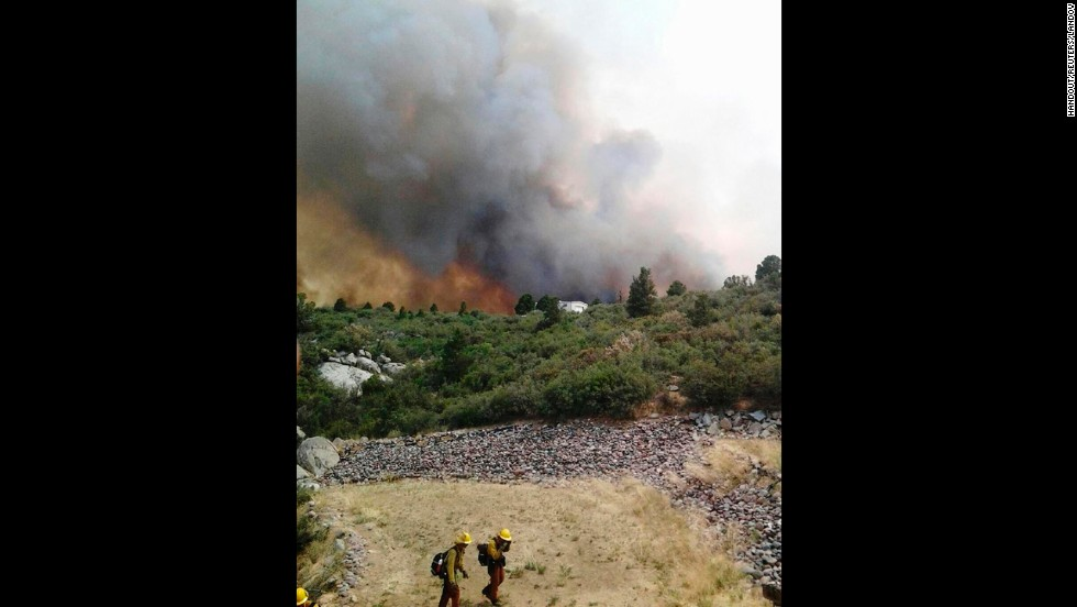 Firefighters move away from the Yarnell Hill Fire, near the town of Yarnell on June 30.