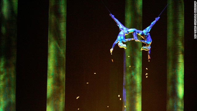 "In this Nov. 28, 2008, photo, Sarah Guyard-Guillot, left, and Sami Tiaumassi perform as ""Forest People"" during Cirque du Soleil's ""Ka"" at MGM Grand Resort in Las Vegas. Guyard-Guillot died in June 2013 after falling from the show's stage during a performance."