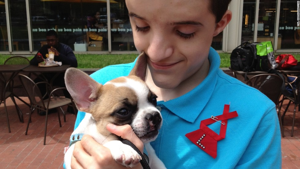 "Lentil is the ""Ambassodog"" for craniofacial differences in children and animals. He and Danny Pfeiffer have a special bond."