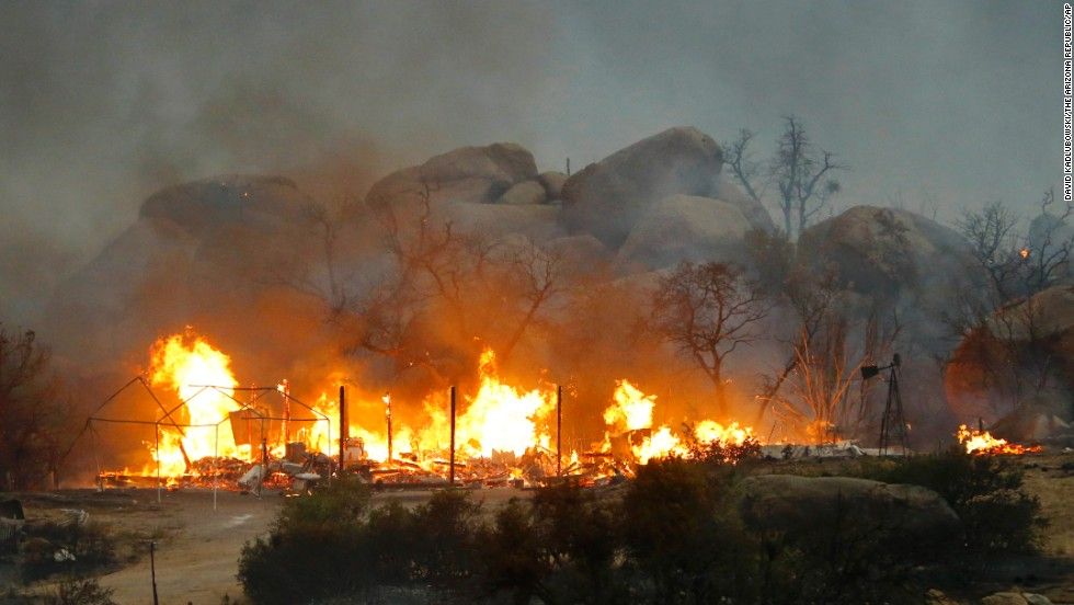 Homes burn on Sunday, June 30, in Glenn Ilah, Arizona, near Yarnell.