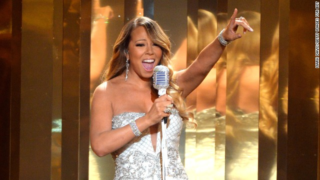 "Mariah Carey reaches for high notes while performing ""Beautiful"" at the 2013 BET Awards on June 30."