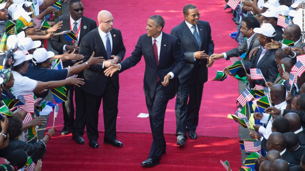 Obama and Kikwete, right, are greeted by a cheering crowd as they arrive at the State House in Dar es Salaam, Tanzania, on Monday, July 1.