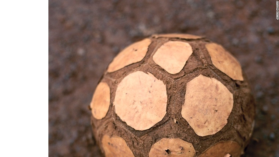 """Am I kicked, beaten, used, crushed and trampled?  Or am I strong, resilient, determined, unbeaten, proud?<br />""I am both.  I am proof that with so little we can do so much.  I am proof that simple pleasures are enduring.<br />""I am a ball.  I am an African ball."""