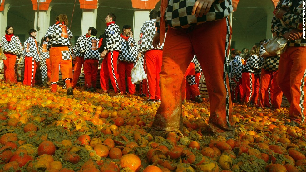 "Every February in the Italian village of Ivrea, participants of the local Carnival engage in the annual ""Orange Battle"". The battle commemorates a popular rebellion against a local tyrant dating back to 1266 A.D."