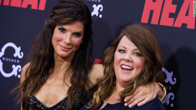 "Hollywood actresses Sandra Bullock and Melissa McCarthy grace the red carpet at ""The Heat"" premiere. The film was a hit at the US box office this weekend grossing at total of $40 million."