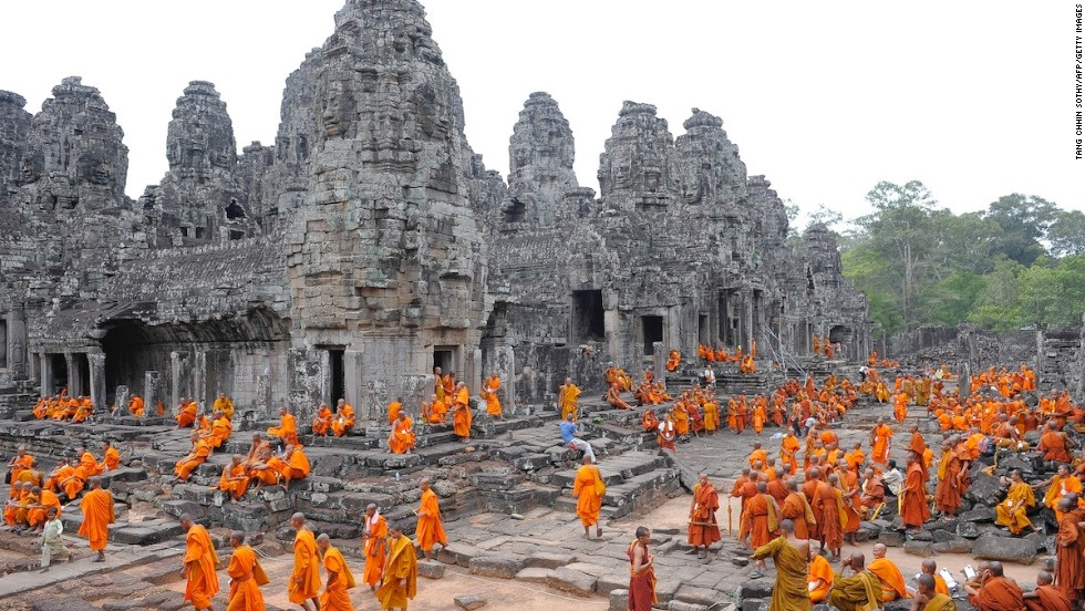 Cambodian Buddhist monks convene for a religious celebration at the famed Bayon Temple, another Angkor highlight.