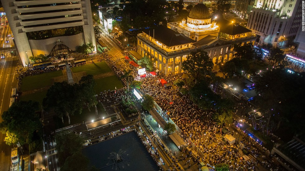 Protesters march on July 1 on Special Administrative Region Establishment Day, marking the16th anniversary of Hong Kong's handover to China.  Thousands of protesters called for universal suffrage and called for the city's leader, Chief Executive C.Y. Leung, to step down.