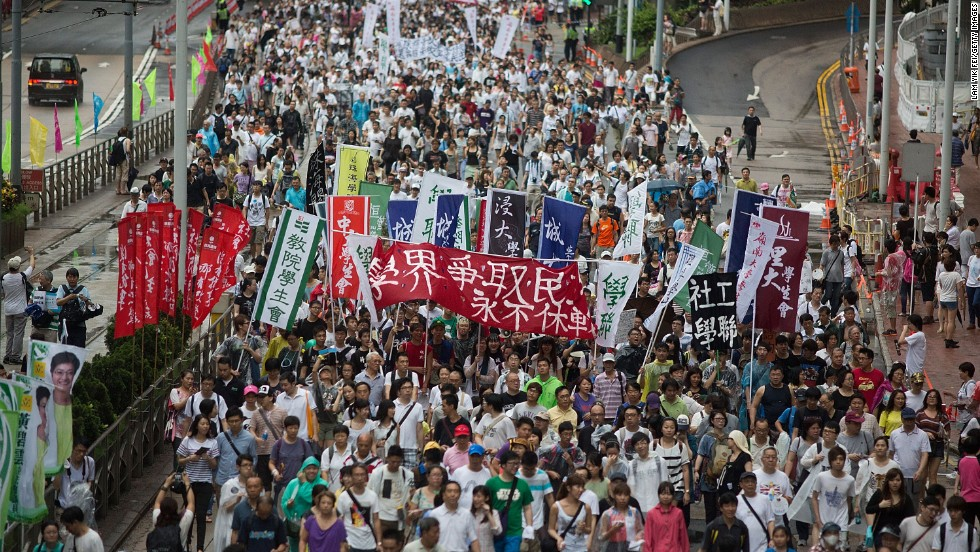 "The Hong Kong government said it will  ""implement universal suffrage for the Chief Executive Election in 2017 strictly in accordance with the provisions of the Basic Law and the relevant decisions of the Standing Committee of the National People's Congress.""  Many doubt that there will be free and fair elections, however."