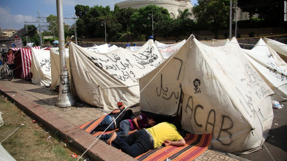Opponents of Morsy camp out as they protest outside the presidential palace in Cairo on July 2.
