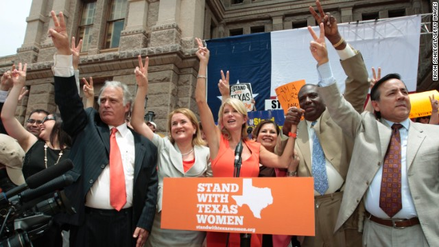 AUSTIN, TX - JULY 01:  Texas Sen. Wendy Davis (D-Ft. Worth) is surrounded by supporting Texas representatives and senators after leading a rally in support of Texas women's right to reproductive decisions at the Texas state capitol on July 1, 2013 in Austin, Texas. This is first day of a second legislative special session called by Texas Gov. Rick Perry to pass an restrictive abortion law through the Texas legislature. The first attempt was defeated after opponents of the law were able to stall the vote until after first special session had ended.  (Photo by Erich Schlegel/Getty Images)
