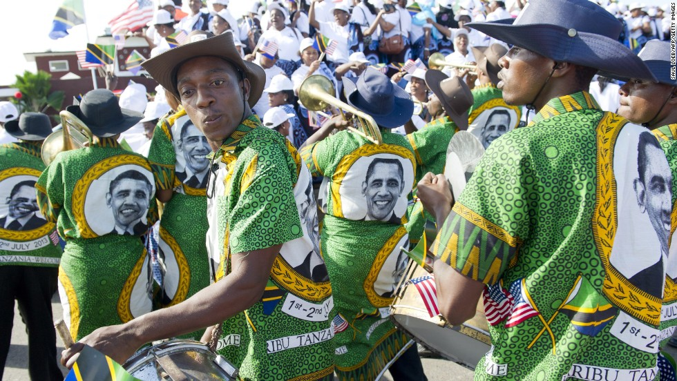 A Tanzanian band plays as the U.S. president and first lady Michelle Obama arrive in Dar es Salaam on Monday, July 1.