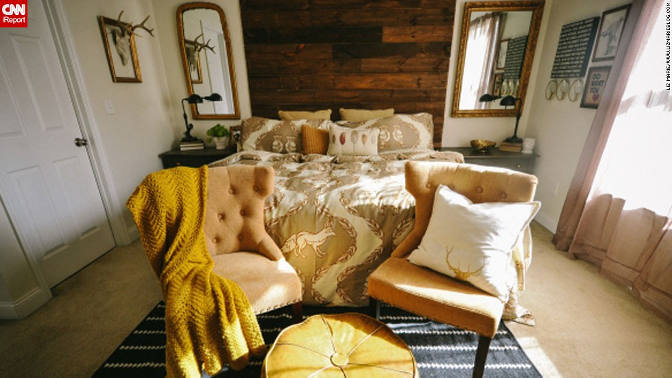 "<a href=""http://ireport.cnn.com/docs/DOC-996649"">Liz Marie,</a> an interior design student and blogger from North Carolina, teamed up with her husband to create a headboard that would be the focal point of their master bedroom. They built their<a href=""http://www.lizmarieblog.com/2012/12/master-bedroom-reveal/"" target=""_blank""> floor-to-ceiling headboard</a> from rustic boards that make a dramatic contrast against their cream bedroom walls."