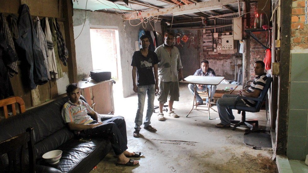 From left to right: Saidur, Hashem, Salim, Hafex, and Johir, refugees from Bangladesh, sit in their home in the slum village of Ping Che on June 25, 2013. All fled their home country due to life-threatening violence, and are now waiting for a refugee status determination.